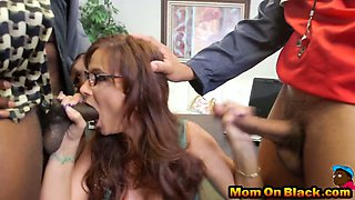 Smoking hot mature babe takes in a meaty penetration while sucking another rod