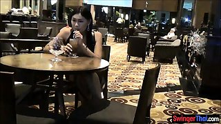 Business man cheating with a very pretty Thai hooker
