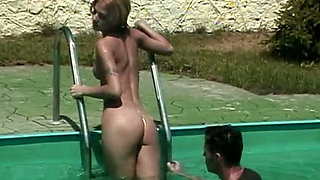 Tanned blonde Christal gets dirty fucked by the pool side