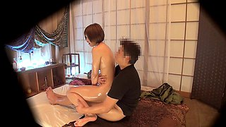 Oil massage leaves her leggy Japanese body wet for dick