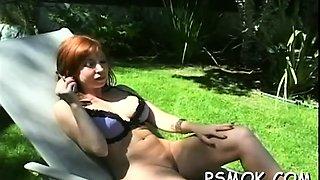 Older slut blows a lad while smoking a cigarette