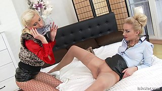 Lesbians in leather skirts pull off their panties and eat pussy