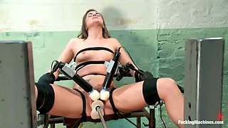 hot brunette has various orgasms with a machine