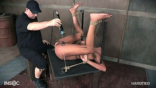 Black chick Verta gets her pussy punished in the dark room