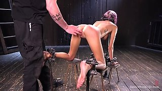 skinny punk babe janice griffith squirts hard in brutal metal bondage