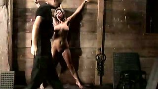 Crucified blondie called KALI gets her pussy tickled by lewd dominant bloke