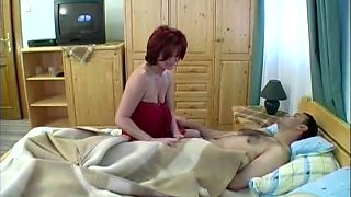 Busty redhead crawls to the dick of a sleeping man