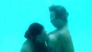 Underwater lesbian kissing