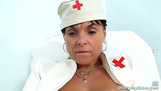 Lewd old nurse Livie uses a vaginal speculum for pleasing her mature cunt