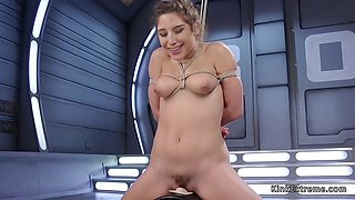 Brunette in bondage fucking machine