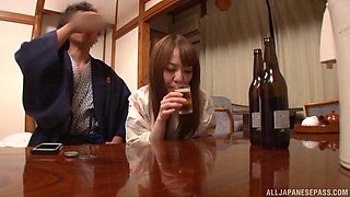 Drunk Japanese babe gives a cute blowjob and gets her hairy muff thrilled on bed