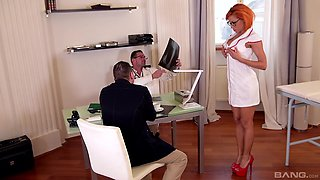 Redhead pornstar Rose Valerie sprayed with cum in a nurse uniform