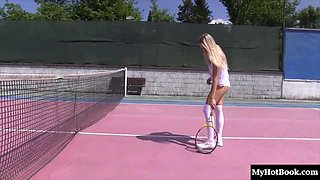 Blonde spreads her legs on a tennis court for her skillful fingers