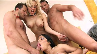 Two great-looking senoritas having a great time in a kinky foursome