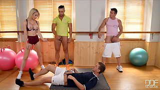 Topless busty trainer gives tugjob and blowjob to a trio of dudes
