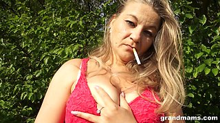 mature smoker plays with her pretty pussy
