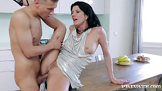 Celine Noiret Scores Young Cock in Kitchen