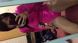 crossdresser in pinkmetallic leotard
