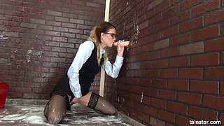 that gloryhole cock is fake but she still wants to have fun with it!