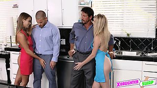 Teen hotties share each others daddy in a foursome