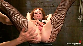 Redhead Is Tied Up And Has A Massive Dick Put In Her