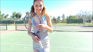 Sexy tennis player drives a lenghty ratchet handle in her hole outdoors