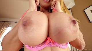 Monstrous tits gets showered with a big load of jizz