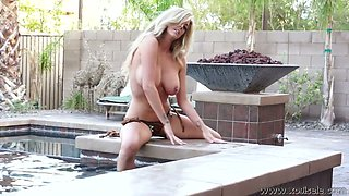 Gorgeous blonde plays with her palatable boobies outdoor