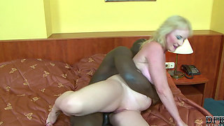 Mature gets BBC in the ass
