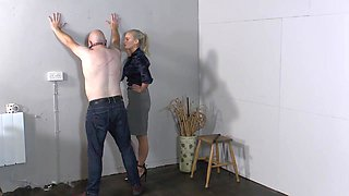 Hot blonde strict mistress disciplines her slave with her whip