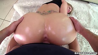 Oiled up tattooed blonde gets rammed from behind
