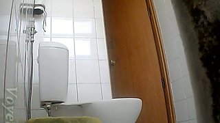 Redhead young white girl pisses in the toilet room and gets recorded on hidden cam