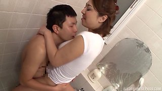 Luscious Asian gal sucks the dick of her lover in the bathroom