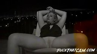 Drunk blonde gets her shaved cunt played with at the rooftop