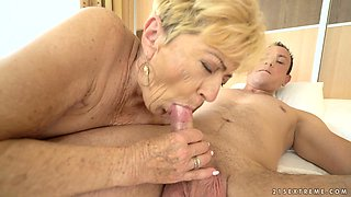 Lascivious granny Malya enjoys her younger stud Rob in bed