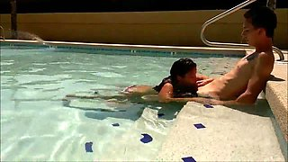 Horny couple having oral sex in the pool