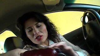 Buxom mature brunette in stockings masturbates in the car
