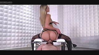 mistress  has her slave under a special chair