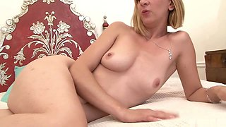 Louise Du Lac is a mature and flexible MILF with soft, floppy tits