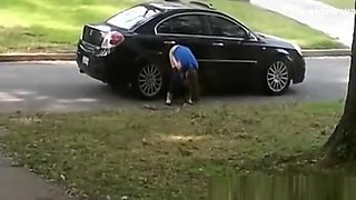 Totally drunk woman peeing on cars