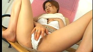 Zealous Japanese hoe in white stuff Maki Hoshino rubs her clit and plays with boobs