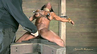 Ebony chick Ashley Starr wears slave hood and gets treated in BDSM way