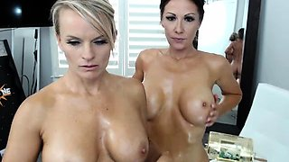 Two big breasted cougars indulge in hot lesbian action
