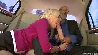 Hot blonde Kacey Jordan blows an amazing monster cock inside the car