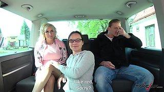 Tattooed blonde MILF Jarushka rides a big hard cock in the car