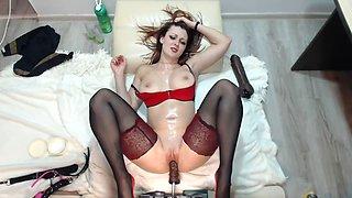 dildo machine between her legs