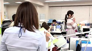 Horny Japanese babes getting fucked together in the office