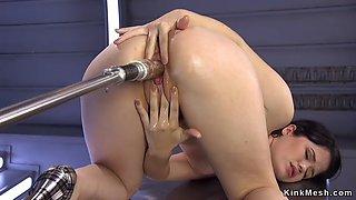 Brunette on her knees and hands fucks machine