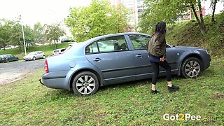 Amateur shameless brunette squats down and pees near the car
