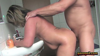 Chubby German mature plays with a big dick on the toilet